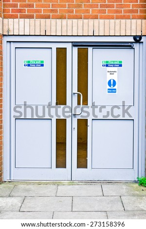 Double fire exit doors in a public building in the UK