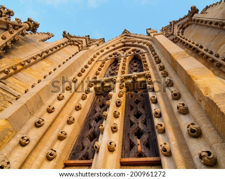 double gothic wood windows with sculptures at the wall of the church, St. Mary, Oxford, UK - stock photo