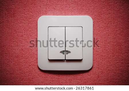 Double light switch against red wall closeup - stock photo