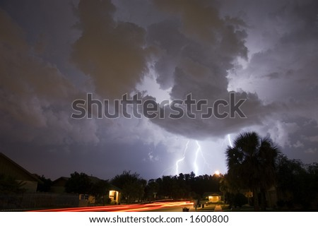 Double Lightning Strike with several cars passing by - stock photo