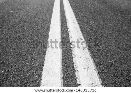 Double lines asphalt road background - stock photo