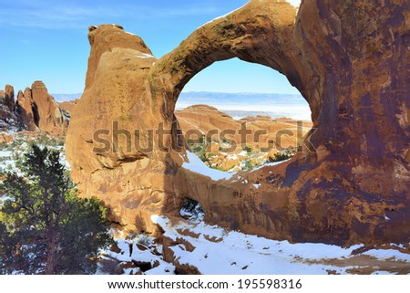 Double-O-Arch in Devil's Garden in Arches National Park, Utah in winter - stock photo