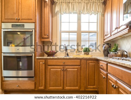 double ovens in wood cabinets in new kitchen