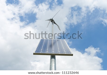 double power supply for an outside measuring instrument by a small solar panel and wind generator - stock photo
