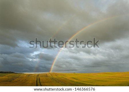 Double rainbow in northern Polands Fields / Central Pomerania district close to Miastko city - stock photo