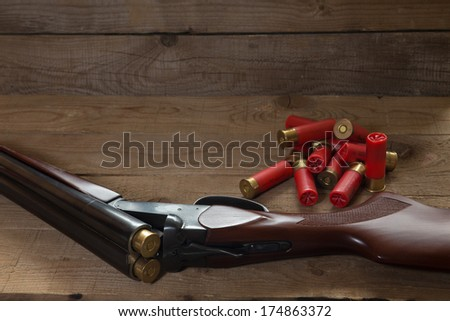 Double shotgun and cartridges - stock photo