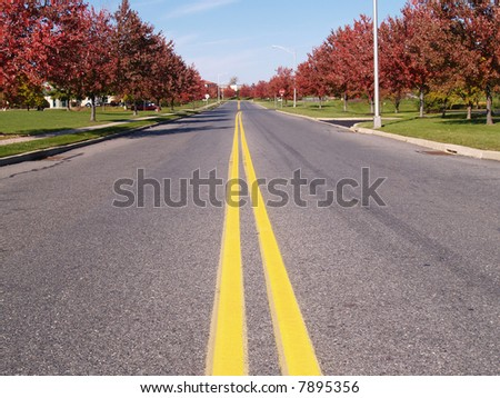 double yellow lines in a road - stock photo