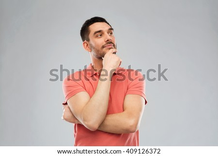 doubt, expression and people concept - man in polo t-shirt thinking over gray background - stock photo