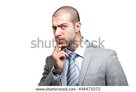 Doubtful businessman isolated on white - stock photo