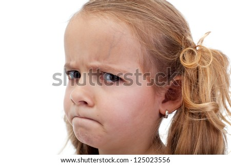 Doubtful little girl looking suspiciously - stock photo