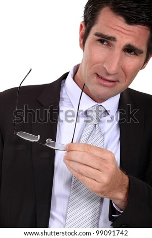 Doubtful man having a second look - stock photo