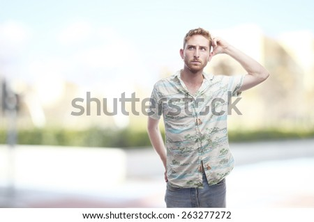 doubtfull ginger young man with hawaiian shirt - stock photo