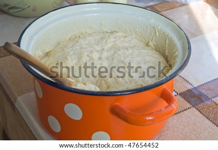dough for the cake in the pan-colored polka dots