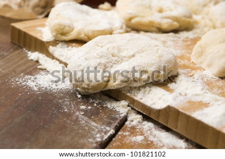 Dough on wooden board - stock photo