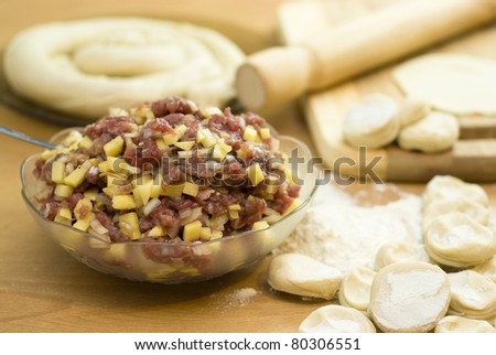 dough with minced meat patties cooking Asian samsa - stock photo