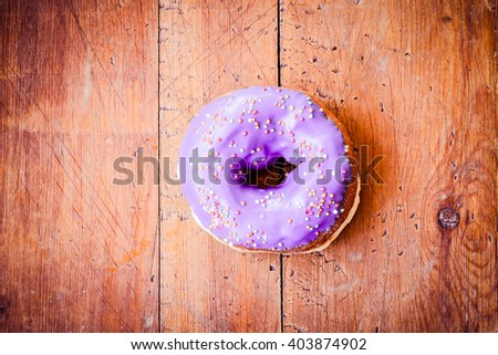 Doughnut. Sweet icing sugar food. Dessert colorful snack. Glazed blue sprinkles. Treat from delicious pastry breakfast. Bakery cake. Doughnut with frosting. Baked unhealthy round.  - stock photo