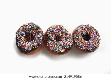 Doughnut with chocolate and colorful rice sugar on top - stock photo