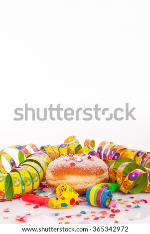 doughnut with confetti and streamer - carnival decoration with copy space on upper section of picture