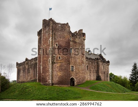 Doune Castle (Northeast corner) on a cloudy spring day.  Doune Castle is a medieval stronghold near the village of Doune, in the Stirling district, central Scotland, UK - stock photo