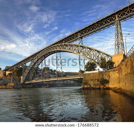 Douro river in Porto and famous bridge - stock photo