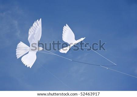 Dove kites. - stock photo