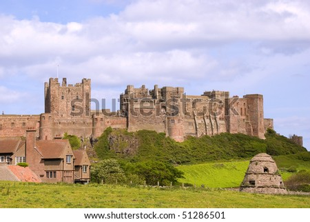 Dovecote at Bamburgh in front of castle - stock photo