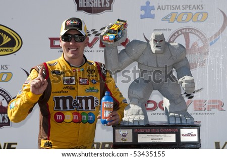DOVER, DE - May 16:  Kyle Busch wins at the Dover International Speedway for the Autism Speaks 400 presented by Hershey's Milk & Milkshakes on May 16, 2010 in Dover, DE - stock photo