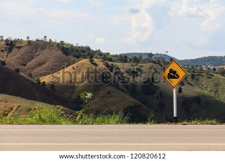 Down hill sign on the road - stock photo