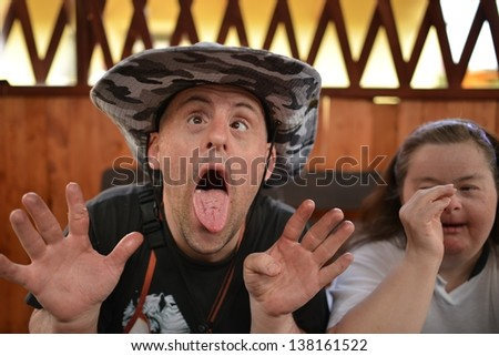 Down syndrome couple in barbecue party - stock photo