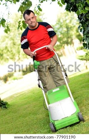 down syndrome man with lawn mower