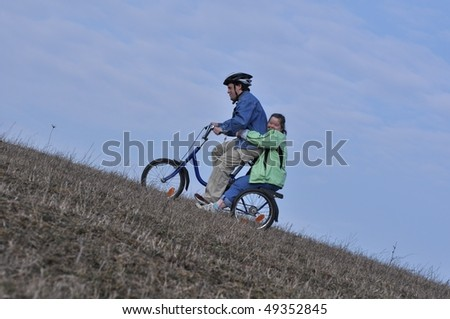 Down syndrome stock photos: love in bike - stock photo