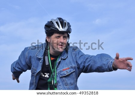 Down syndrome stock photos: man in bike - stock photo