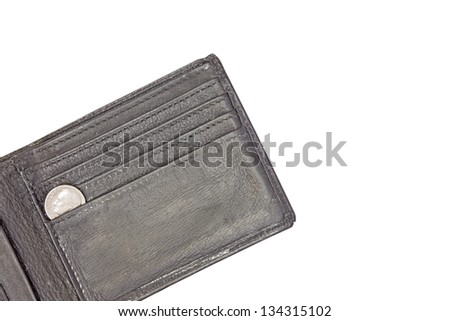 Down to the last dime. Open, old black leather wallet with one shiny dime inside. Isolated on a white background. Room for text. - stock photo