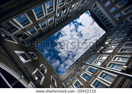 down-up view in classic architecture courtyard - stock photo
