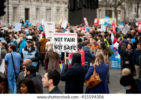 Downing Street, London, UK. 6th February 2016. EDITORIAL - Junior doctors and supporters, march through central London, in protest of government plans to change NHS junior doctor contracts.