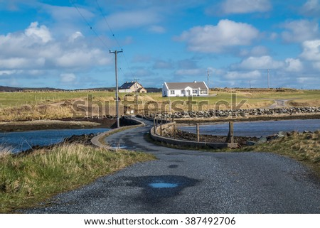 DOWNINGS / IRELAND - MARCH 08 2016 : Island of Roy bridge in the sun