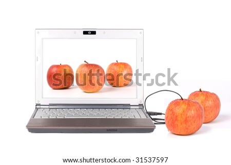 Download real apple from the laptop by USB, From desktop to tabletop. - stock photo