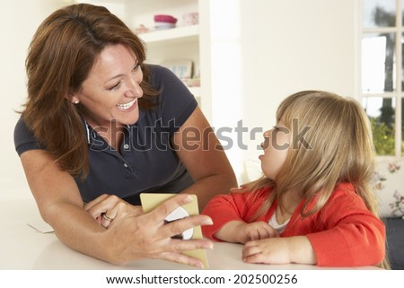 Downs Syndrome boy having speech therapy - stock photo