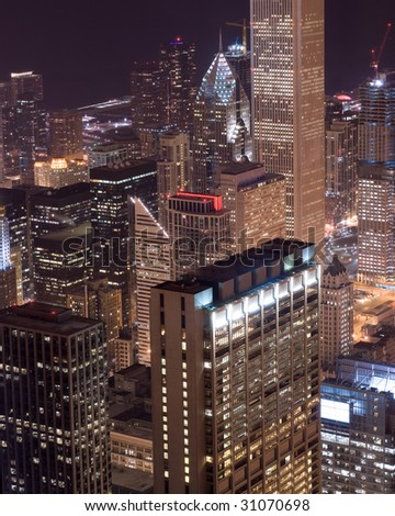 Downtown Chicago buildings glow with light at twilight