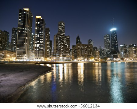 Downtown Chicago waterfront and beach at night.