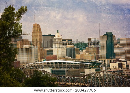 Downtown Cincinnati with the football stadium in the foreground.  This image has been treated with a texture overlay. - stock photo