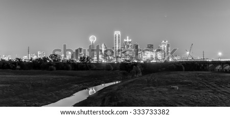 Downtown Dallas skyline at night from the Trinity River in Texas, USA. - stock photo