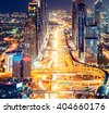 Downtown Dubai architecture by night. Aerial view of illuminated skyscrapers and highway. Famous travel destination. - stock photo