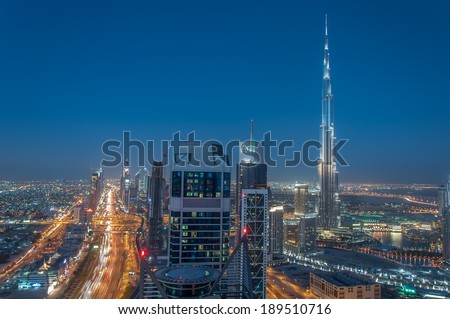 DOWNTOWN DUBAI, UAE - Feb 5: Burj Khalifa, the tallest skyscraper in the world standing at 829.8m in Dubai on Feb 5,2013. Construction began in 2004 and officially opened in 2010. Shot at Blue hour. - stock photo