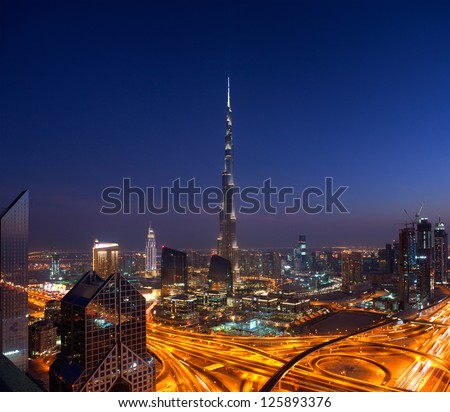 DOWNTOWN DUBAI, UAE - NOVEMBER 2: Burj Khalifa, the tallest skyscraper in the world standing at 829.8m in Dubai on Nov. 2, 2011. Construction began in 2004 and officially opened in 2010. - stock photo