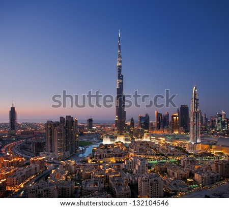 DOWNTOWN DUBAI, UAE - OCT 15: Skyline view of Downtown Dubai showing the Burj Khalifa and Dubai Fountain on Oct 15, 2010 in Dubai, UAE. The Burj Khalifa, the tallest skyscraper in the world at 829.8m - stock photo