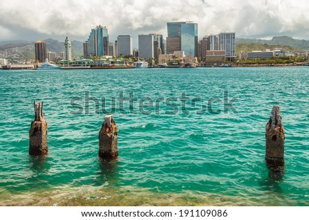 Downtown Honolulu as seen from across Honolulu Harbor - stock photo