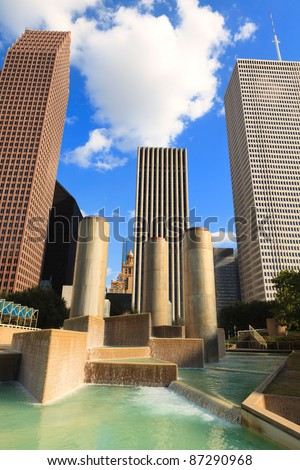 Downtown Houston, Texas cityscape with fountain and tall skyscrapers. - stock photo