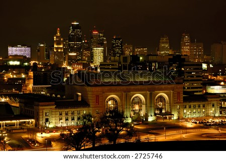 Downtown Kansas City Missouri with Union Station in the foreground on a winter night. - stock photo