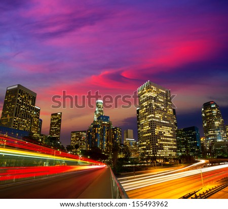Downtown LA night Los Angeles sunset skyline California from 110 freeway - stock photo